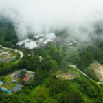 Aerial view of geothermal power production plant. Geothermal power station near to the active volcano Apo. Mindanao, Philippines
